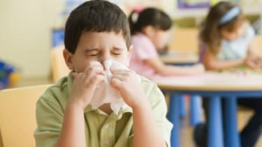 """The common sneeze response """"bless you"""" is under fire thanks to one California teacher who banned its use in his classroom."""