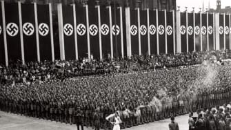 The Olympic torch arrives at the start of the summer Olympics in Berlin, 1936.