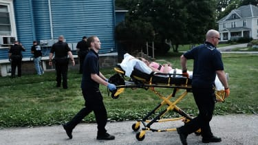 Medical workers take away a woman who has overdosed on heroin in Warren, Ohio.
