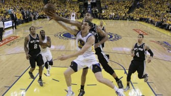San Antonio Spurs' Tim Duncan blocks a shot by Golden State Warriors' Klay Thompson.