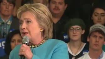 """N.H. speech attendee sports """"Settle for Hillary"""" shirt."""