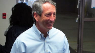 Congressional hopeful Mark Sanford leaves the voting booth on April 2 after casting his ballot at his precinct in Charleston, S.C.