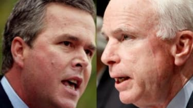 John McCain and Jeb Bush: at odds over Arizona's controversial immigration bill.