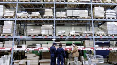 Ikea workers help a customer.