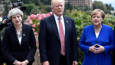 British Prime Minister Theresa May, U.S. President Donald Trump, German Chancellor Angela Merkel.