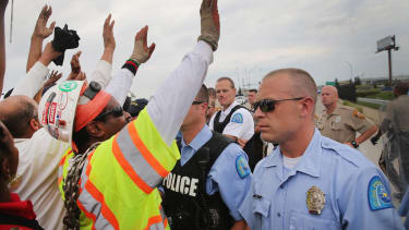 35 arrested in clash at a Ferguson protest