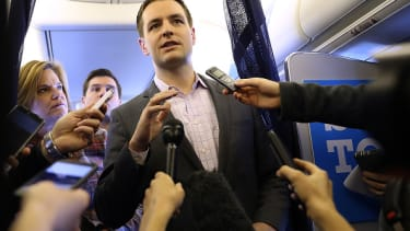 Robby Mook speaks to reporters on Clinton's campaign plane two weeks before the election.
