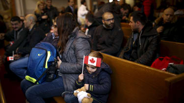 Welcoming refugees into Canada.