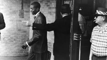 An unidentified young black 'Freedom Rider' is told to leave a segregated white waiting room at a bus depot in Jackson, Miss., May 26, 1961.