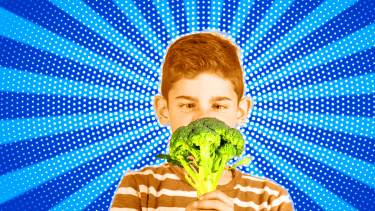Fussy kid looking at broccoli.