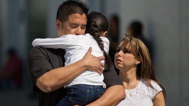 A family reunites after the shooting in San Bernardino.