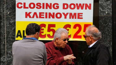 Cypriot shop owners chat about the disturbing financial state of Cyprus, March 22.