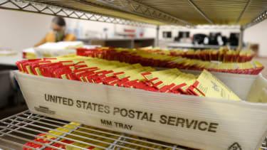 Mail-in ballots at a postal sorting facility.