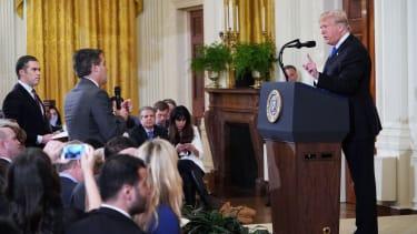 Jim Acosta and Donald Trump.