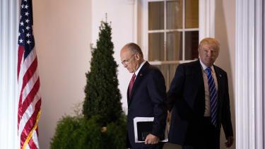Andrew Puzder departs after a meeting with Donald Trump