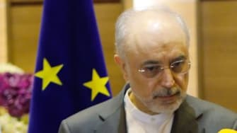 Iran's vice president and head of the Iranian Atomic Energy Organisation, Ali Akbar Salehi (L) and Arias Canete, European Union Energy Commissioner
