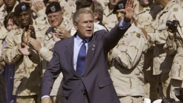 President Bush waves to the soldiers of the Army's 3rd Infantry Division during a visit to Ft. Stewart, Ga., Sept. 12, 2003.