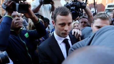 Judge finds Oscar Pistorius not guilty of murdering girlfriend Reeva Steenkamp