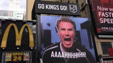 A giant sign featuring Will Ferrell shouting 'Go Kings, Go!' taunted New Yorkers on Friday