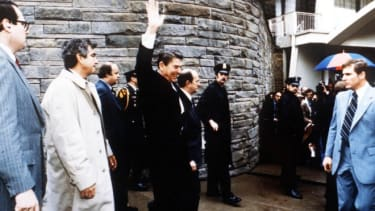 President Ronald Reagan waves to onlookers moments before an assassination attempt by John Hinckley Jr. on March 30, 1981.