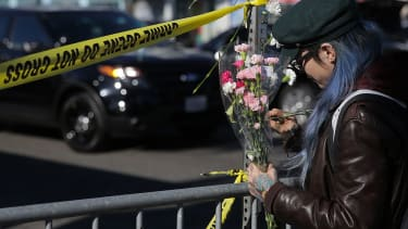 A woman mourns those lost in an Oakland warehouse fire