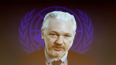 Julian Assange may turn himself in to London police on Friday