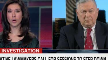 Dana Rohrabacher and CNN anchor.