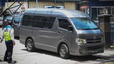 A grey van believed to be carrying Kim Jong Nams body.