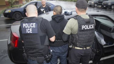 ICE officers make an arrest