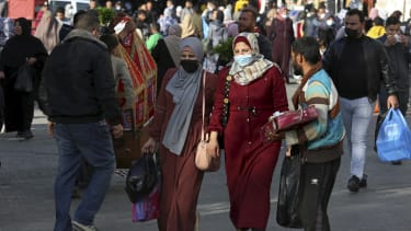 People walk through the main market in Gaza City on Sunday.
