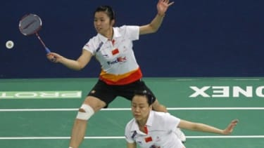 Professional female badminton players wear shorts during a 2011 tournament in Malaysia: The Badminton World Federation will force elite-level women to wear skirts and dresses.