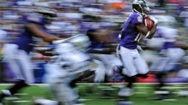Wide receiver Jacoby Jones #12 of the Baltimore Ravens returns a 105-yard kick-off return for a touchdown against the Oakland Raiders.