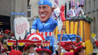 A carnival float in Cologne Germany depicts President Obama as comic book hero Captain America