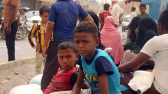 Yemeni children receive food aid in the coastal city of Hodeidah on June 14, 2018.