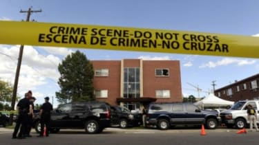 Police surround the apartment of James Holmes, the suspect in the Aurora, Colo., theater shooting. Numerous explosive devices were found in the apartment and successfully disarmed.