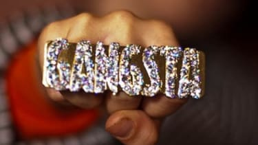 """A teenager shows off his """"Gangsta"""" bling: At a Minnesota high school, white students reportedly treated a dress-up day during spirit week as an opportunity to wear clothes that they believed"""