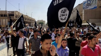 This file photo from 2014 shows ISIS supporters in Mosul, Iraq.