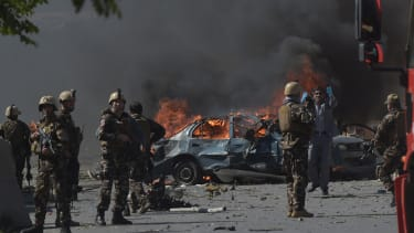 Afghan security forces at a car bomb site