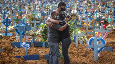 Mourners at a Brazilian cemetery.