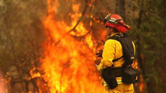 A firefighter battling the Carr Fire.