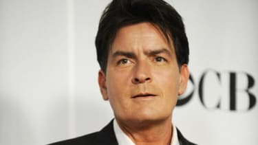 """Charlie Sheen stands backstage at the People's Choice awards in 2009: The troubled actor is returning to TV after being kicked off """"Two and a Half Men."""""""