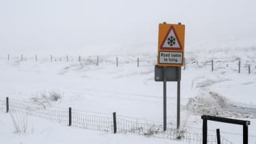 A road sign warning of icy roads in Scotland.
