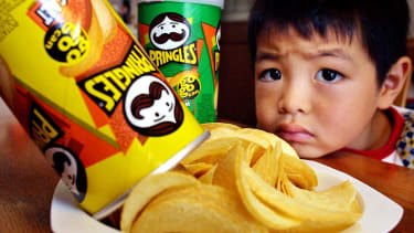 A Japanese boy looks at potato chips