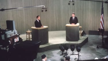 Richard Nixon (left), debates John F. Kennedy (right), during a live broadcast of their fourth presidential debate on October 21, 1960.