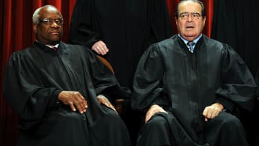 Justices Thomas and Scalia are very upset that the Supreme Court let an assault weapon ban stand