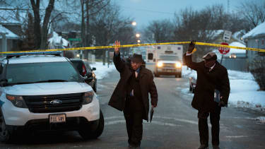 Police arrive at the scene of a quadruple homicide in Chicago earlier this month.
