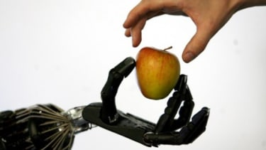 """Engineers are working on an artificial """"e-skin"""" that can help robots negotiate the world in a more delicate and careful way."""