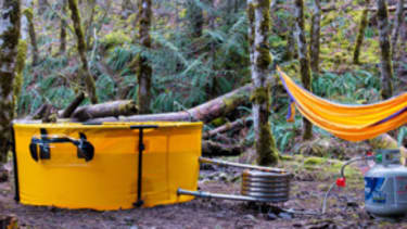 A collapsible, portable hot tub