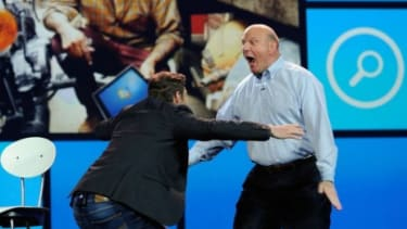 Ryan Seacrest and Steve Ballmer go in for a hug during the Microsoft CEO's final keynote speech at the Consumer Electronics Show in Las Vegas.