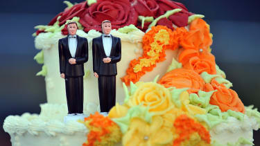 Wedding cake with two men.